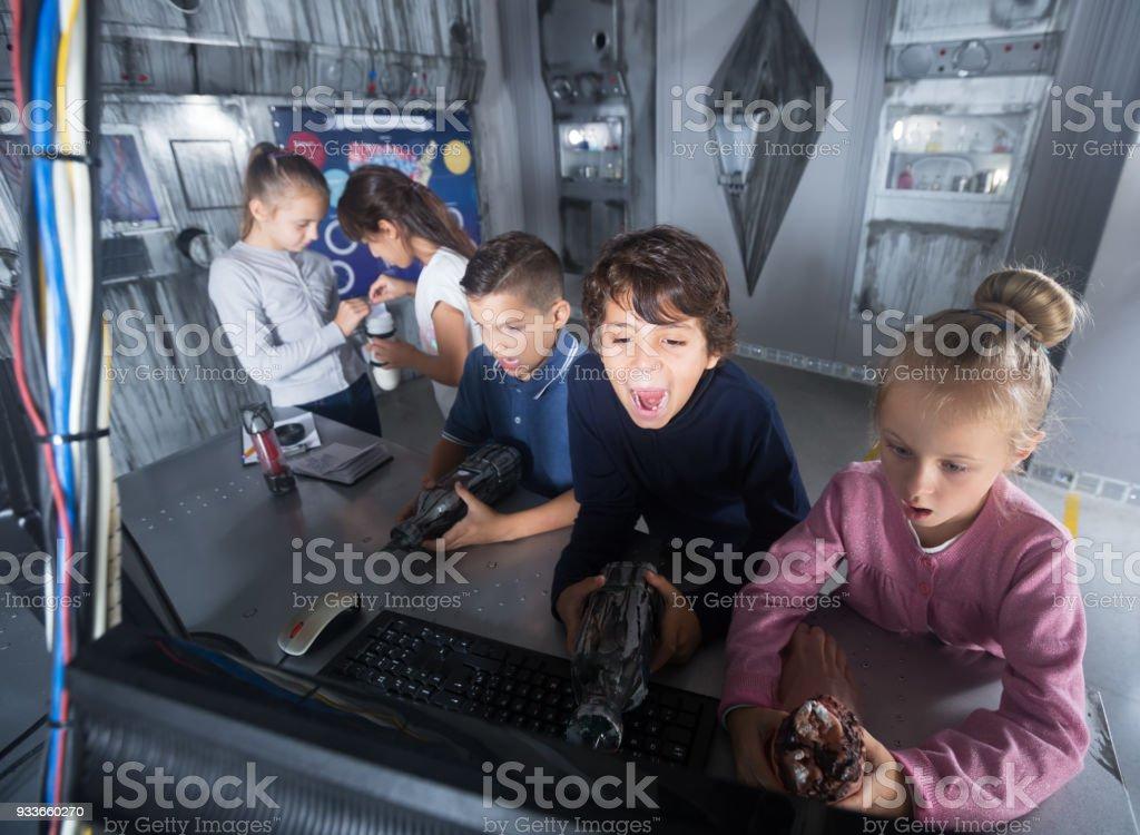 Children playing in bunker questroom stock photo