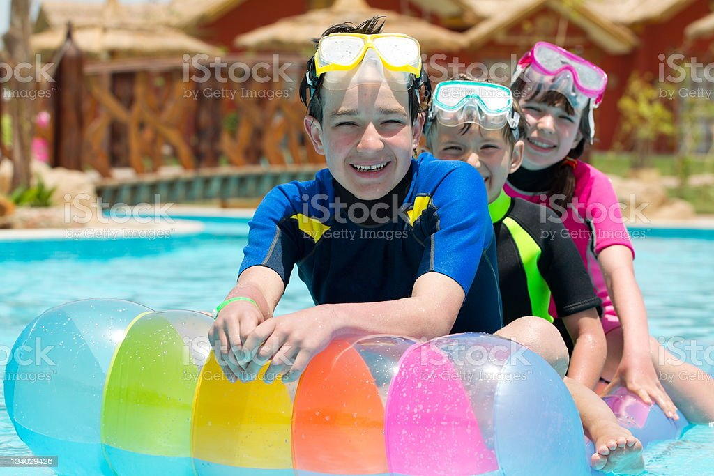 Children playing in pool royalty-free stock photo