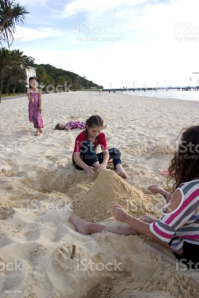 Children Playing in Sand at Beach royalty-free stock photo