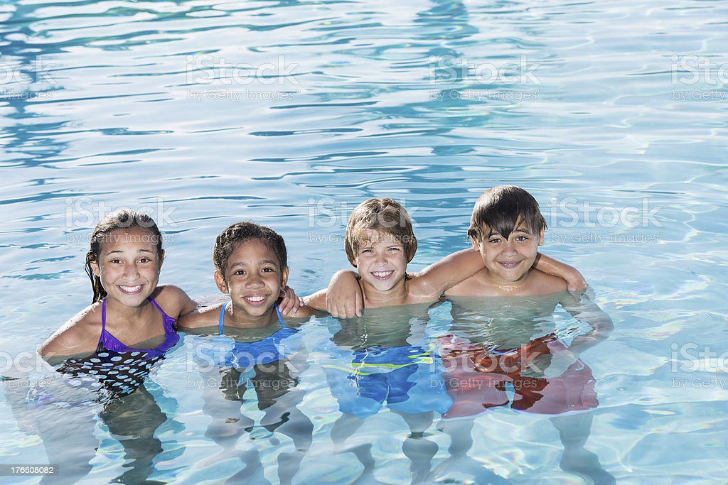 Children playing in swimming pool. royalty-free stock photo