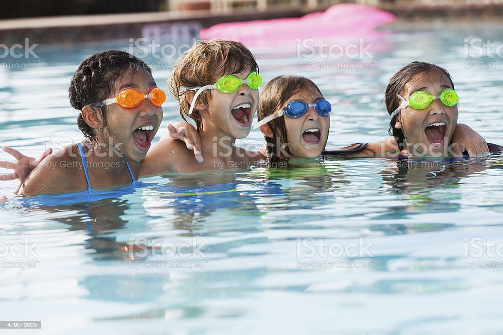 Children playing in swimming pool stock photo