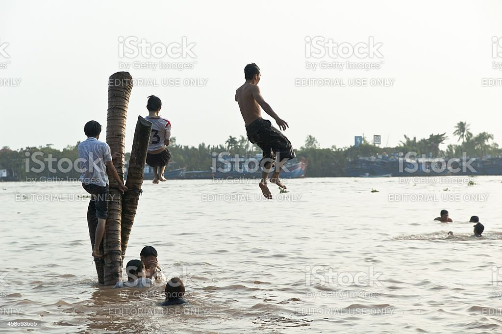 Children Playing In The Mekong River, Vietnam stock photo