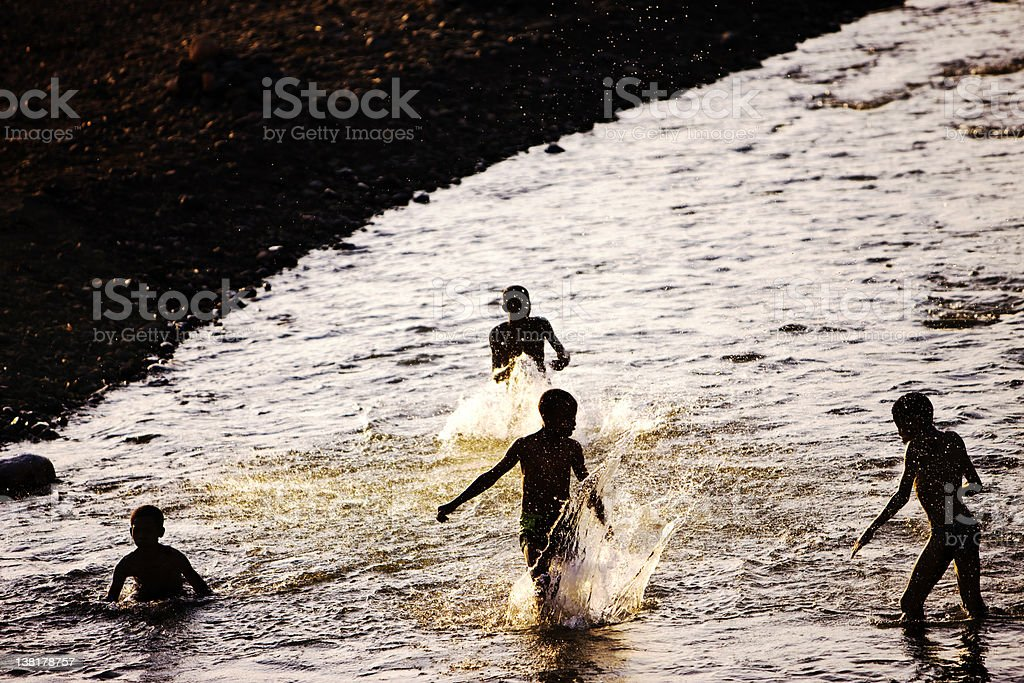 Children playing in the Omo river royalty-free stock photo