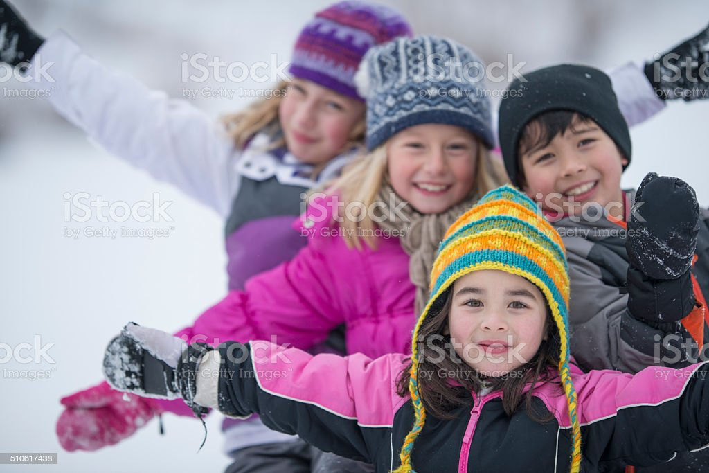 Children Playing in the Snow stock photo