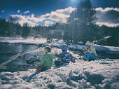 Children playing in a snowy wilderness after a big storm in California in winter