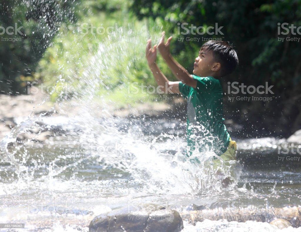 Children playing in the stream stock photo