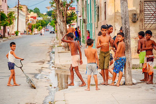 children playing in the street, cuba - disinherit stock pictures, royalty-free photos & images