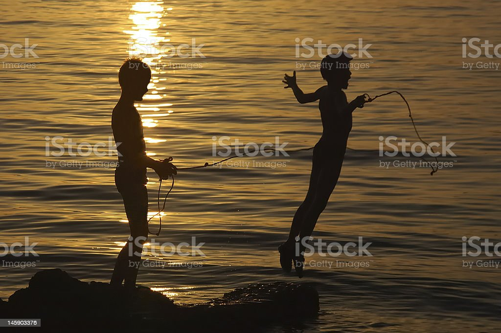 Children playing in the water stock photo
