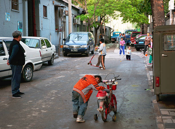 Children Playing on A Historic Beijing Hutong Street at Sunset