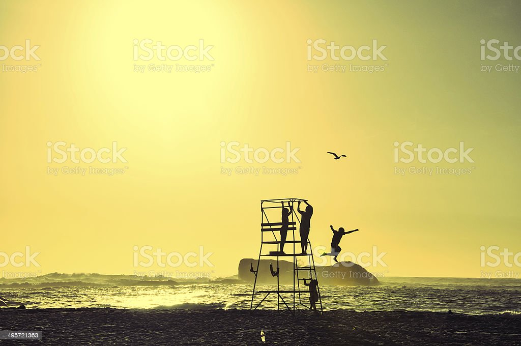 Children playing on a lifeguard chair - Cape Town stock photo
