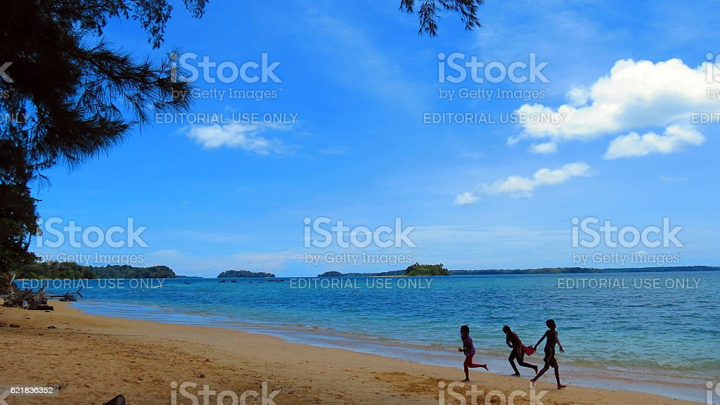 Children playing on a tropical beach stock photo