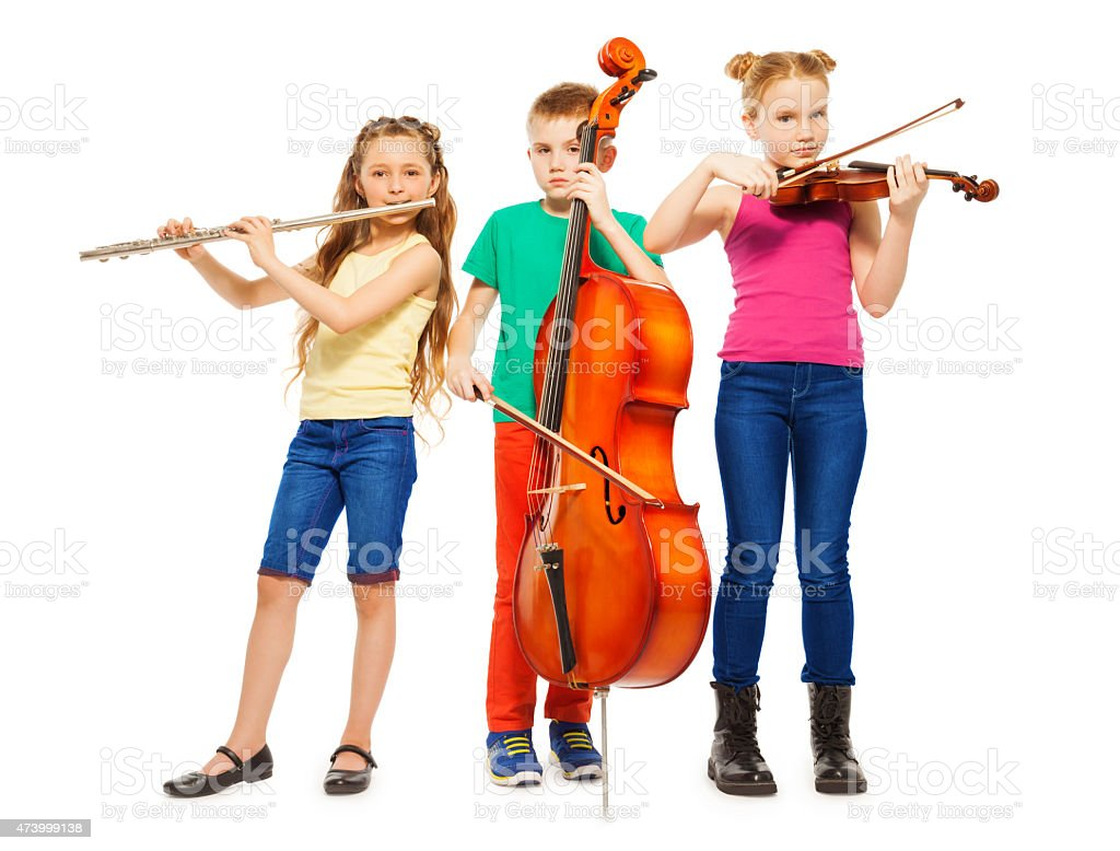 Children playing on musical instruments together stock photo
