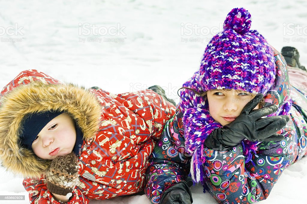 children playing on snow in winter time royalty-free stock photo