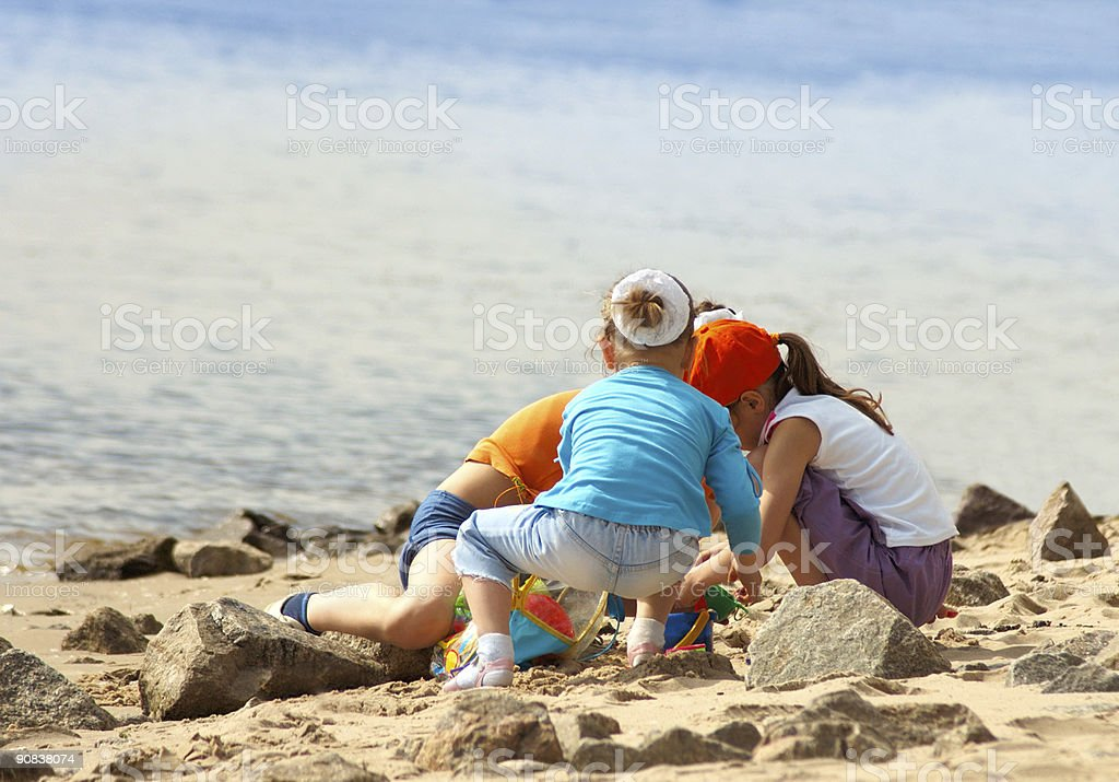 Children playing on the beach royalty-free stock photo