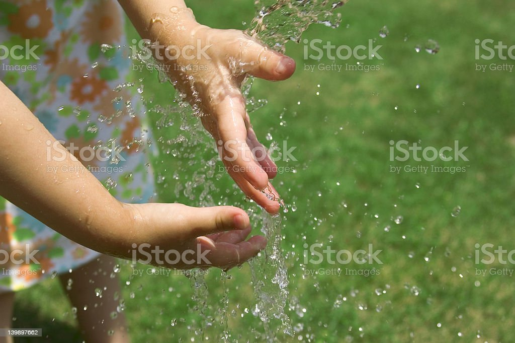 Children playing outside with water stock photo