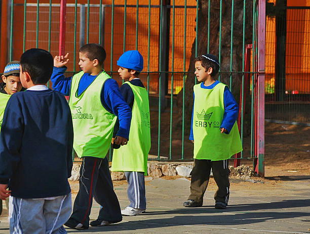 Children playing soccer in school yard, Tel Aviv, Israel stock photo