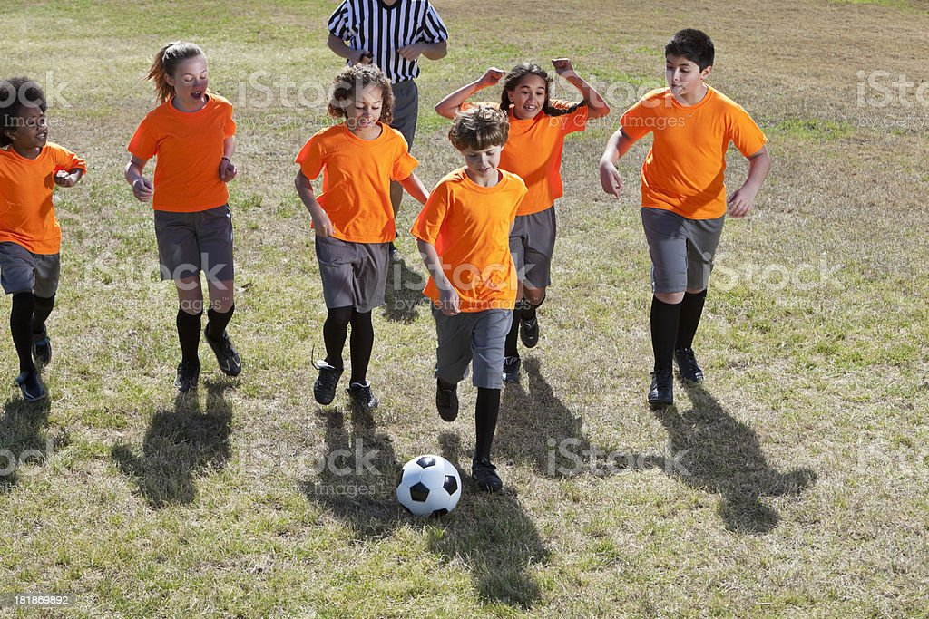 Children playing soccer royalty-free stock photo