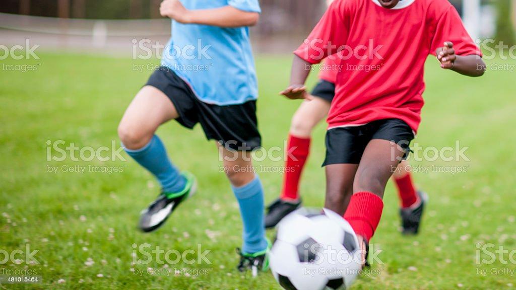 Children Playing Soccer stock photo