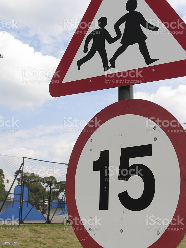Children Playing Speed Limit Sign royalty-free stock photo