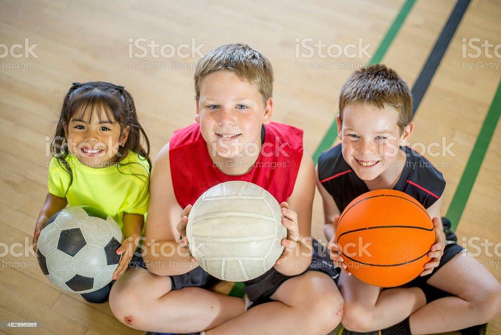 Enfants jouant Sports - Photo