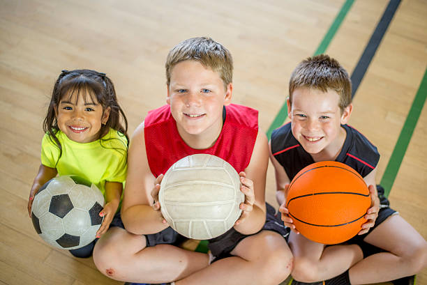 children playing sports - volleyball sport stock photos and pictures