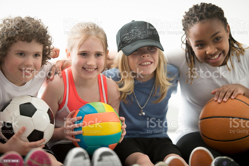 Children Playing Sports Together stock photo