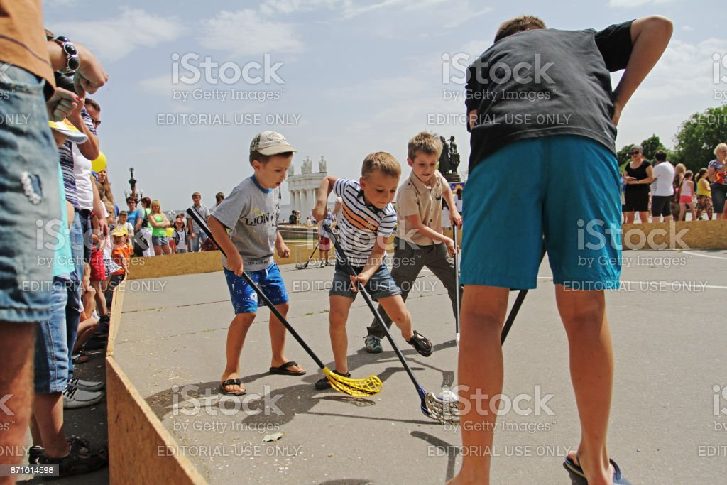Children playing street hockey on Children Protection Day in Volgograd stock photo