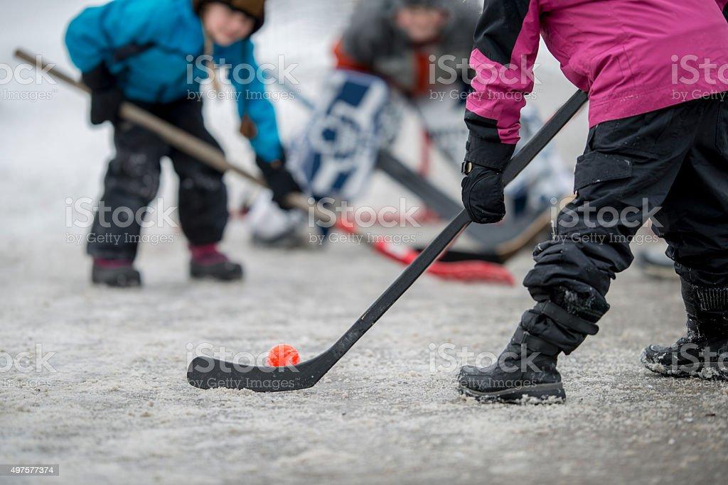 Children Playing Street Hockey stock photo