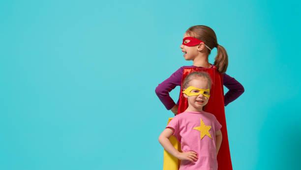 children playing superhero - baby super hero imagens e fotografias de stock