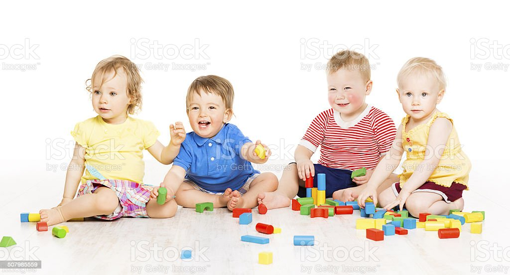Children playing toy blocks. Baby Kids over white background stock photo