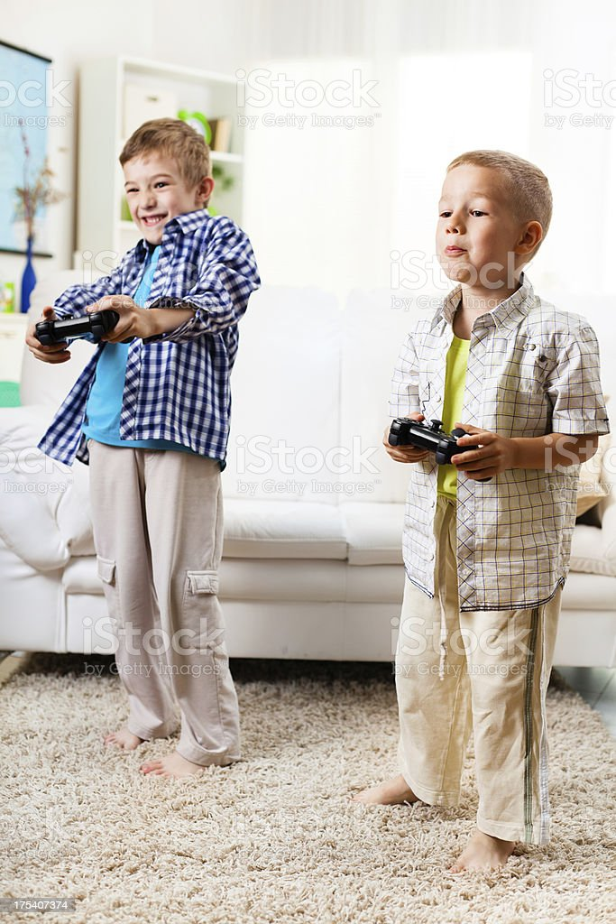 Children playing video games royalty-free stock photo