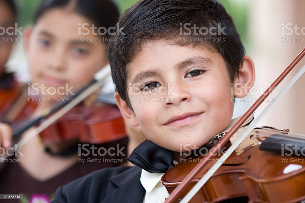 Children playing violins in a classical music concert stock photo