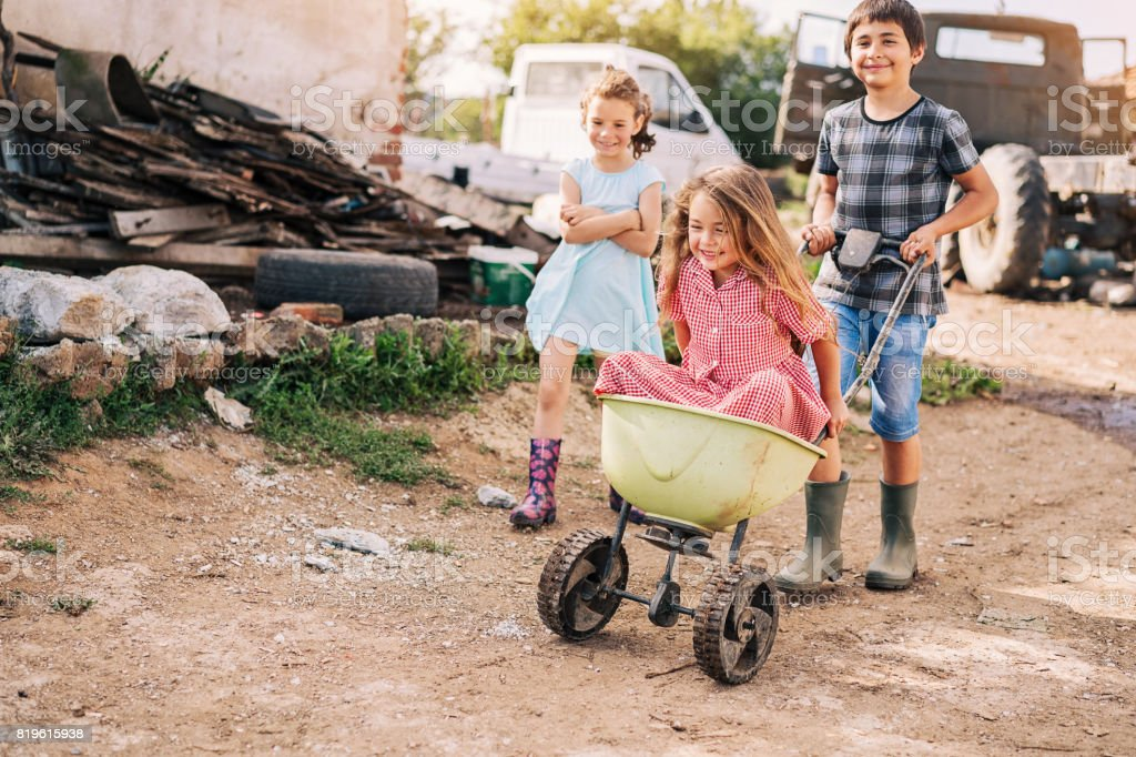 Children playing with a cart stock photo