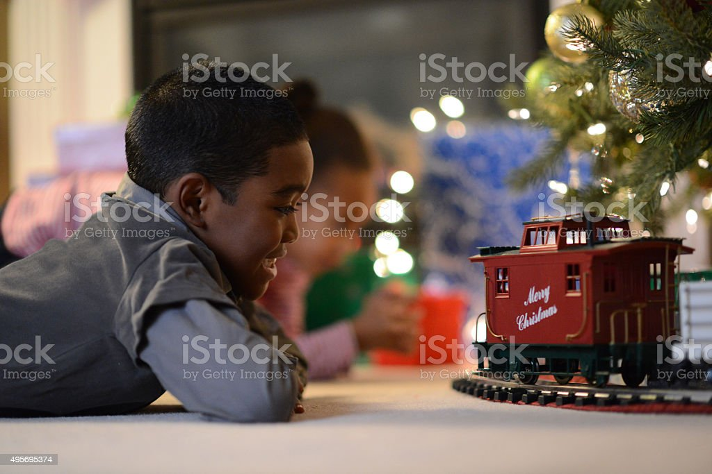 Children Playing with a Toy Train stock photo