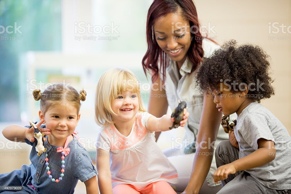 Children Playing with Animals in Day Care stock photo