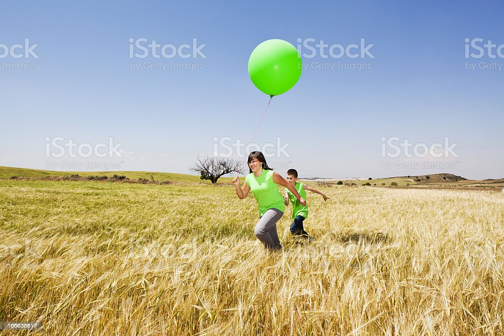 Children playing with balloon royalty-free stock photo