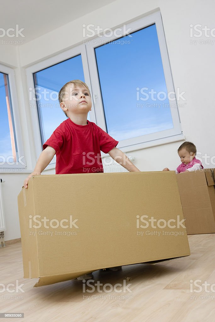 Children playing with boxes royalty-free stock photo
