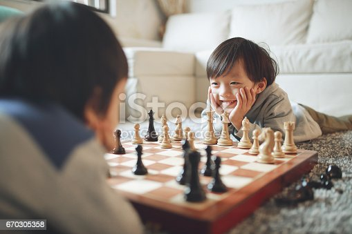 Children playing with chess