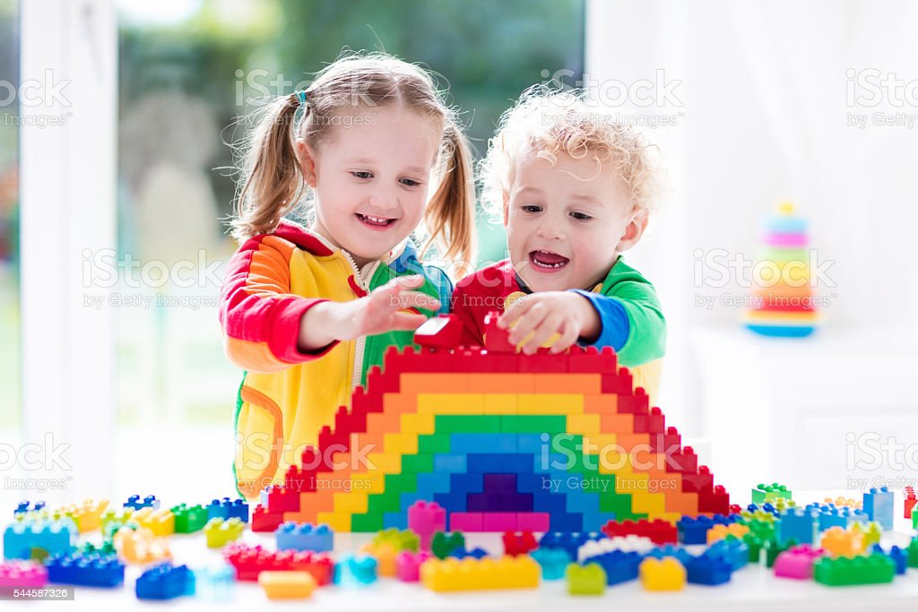 Children playing with colorful blocks stock photo