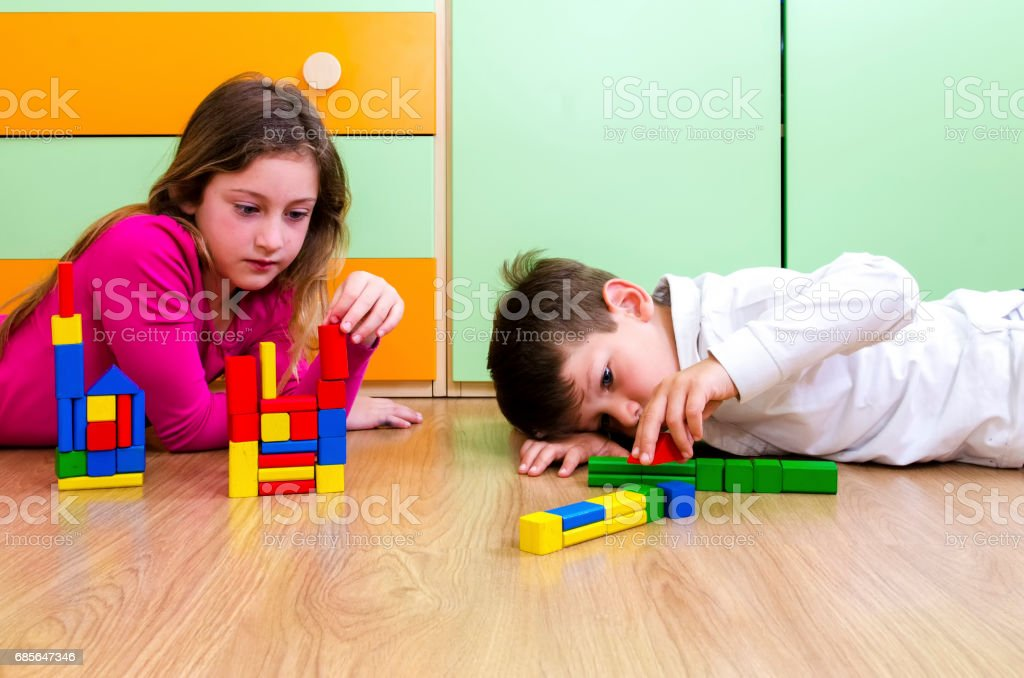 Children playing with construction toy blocks stock photo