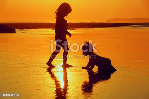 497142294 istock photo Children playing with fun on the sunset sea beach 480504714