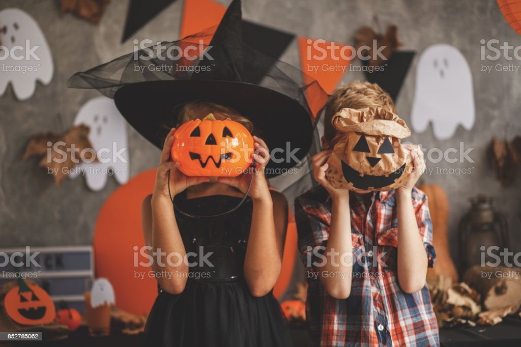 Children playing with Halloween decoration stock photo