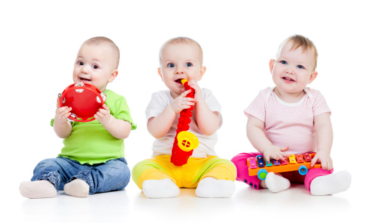 kids girls playing with musical toys on white background