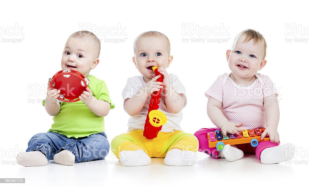 Children playing with musical toys on white background stock photo
