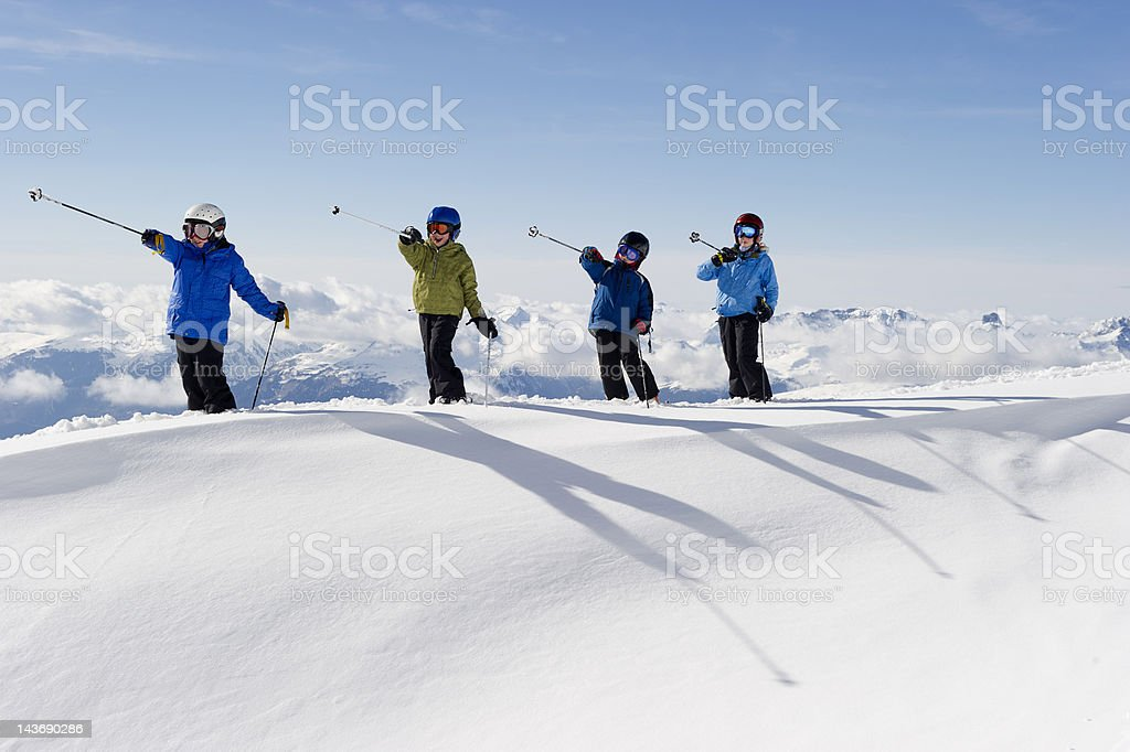 Children playing with ski poles in snow stock photo
