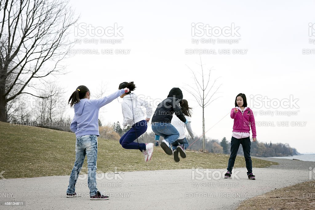Children Playing with Skip Rope, Spring stock photo
