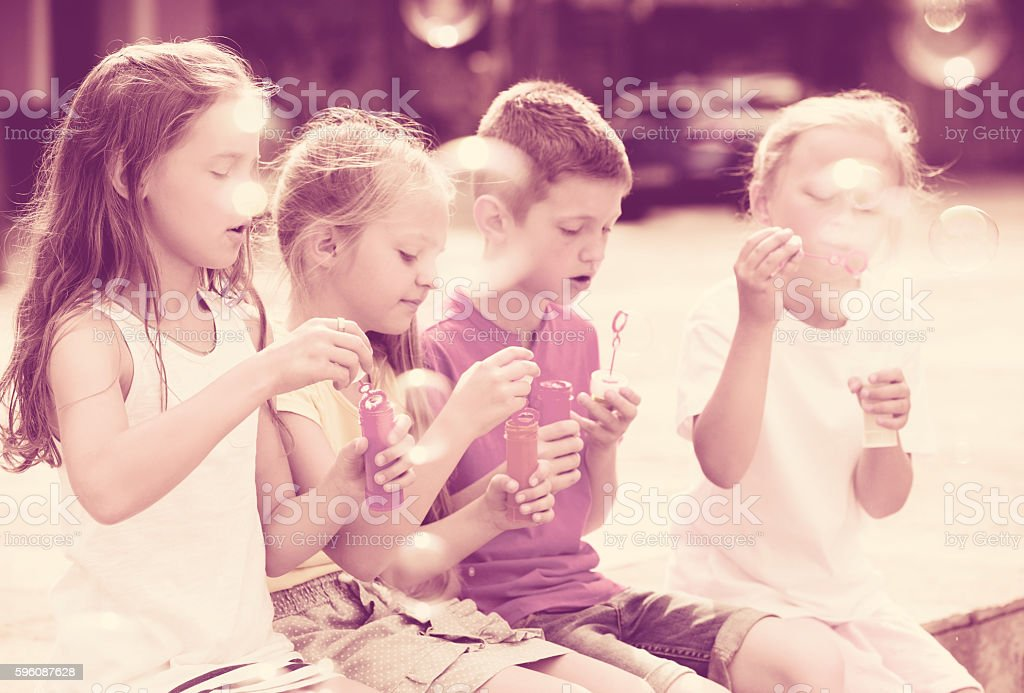 Children playing with soap bubles royalty-free stock photo
