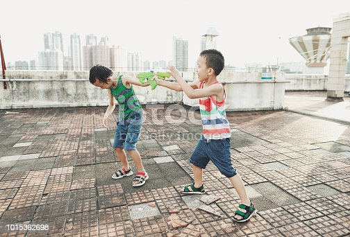 Children playing with squirt gun
