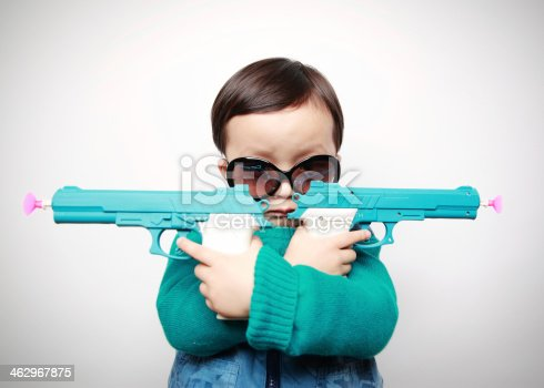 istock Children playing with toy guns 462967875