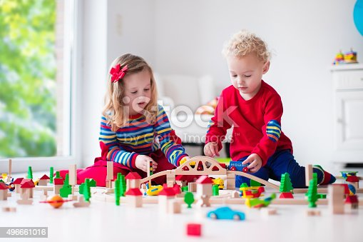 istock Children playing with toy railroad and train 496661016